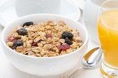 Muesli and orange juice for breakfast — Stock Photo