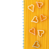 Spaghetti and pasta in the form of heart on a napkin, isolated — Stock Photo