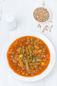 Tomato soup with green lentils and vegetables, top view — Stock Photo