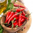 Fresh chili pepper garlic, spices and oil on a wooden board — Stock Photo