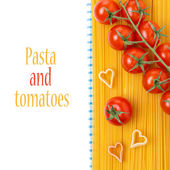 Spaghetti, pasta in the form of hearts and cherry tomatoes — Stock Photo