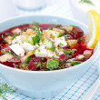 Cold beetroot soup with cucumbers, eggs and herbs in a blue bowl — Stock Photo