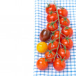 Colorful cherry tomatoes on a blue napkin, isolated — Stock Photo #39735051