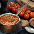 Spicy tomato soup with rice and vegetables in a saucepan — Stock Photo