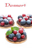 Mini cakes with chocolate cream and berries — Stock Photo