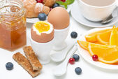 Breakfast with eggs, toasts, croissants, fresh berries, orange — Stock Photo