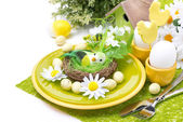 Festive Easter table setting with decorations and flowers — Stock Photo