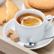 Stockfoto: Black tewith lemon and cookies