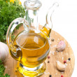 Bottle of olive oil, garlic, spices and fresh herbs — Stock Photo