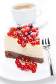 Piece of cheesecake with red and black currants — Stock Photo