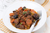Stew with beef and vegetables on the plate, top view — Stock Photo