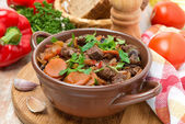 Stew with beef, prunes, vegetables and parsley — Stock Photo
