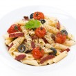 Pasta with sausage, cherry tomatoes and olives, isolated — Stock Photo #41462473