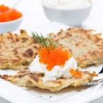 Potato pancakes with red caviar and sour cream — Stock Photo #41683529