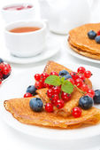 Breakfast with pancakes, fresh berries and black tea on white — Stock Photo