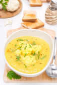 Cauliflower soup with curry in a bowl, top view — Stock Photo