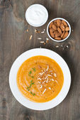 Carrot soup with almonds and yogurt, top view — Stock Photo