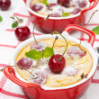 Stock Photo: Casserole (clafoutis) with cherry in ramekin