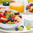 Fresh fruit salad and cream for breakfast — Stock Photo #41925497