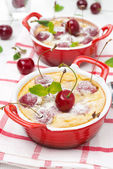 Casserole (clafoutis) with cherry in the ramekin — Stock Photo