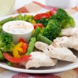 Chicken fillet, steamed vegetables and yoghurt sauce, close-up — Stock Photo #42196597