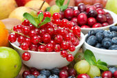 Assorted fresh fruit and berries, close-up — Stock Photo