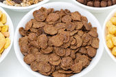 Chocolate cornflakes and breakfast cereals, top view — Stock Photo