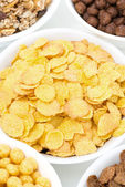 Cornflakes and breakfast cereals, close-up, top view — Stock Photo