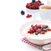 Semolina porridge with fresh berries, nuts and cup of coffee — Stock Photo