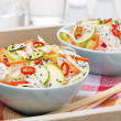 Thai salad with vegetables and chicken in a bowls — Stock Photo