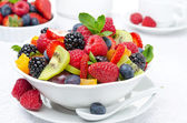 Salad of fresh fruit and berries in a white bowl, berries — Stock Photo