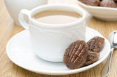 Madeleine cookies and a cup of coffee with milk, horizontal — Stock Photo