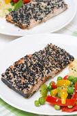 Pink salmon fillet in sesame — Stock Photo