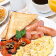 Scramble eggs with tomatoes, grilled sausages and toast — Stock Photo