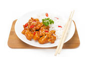 Chinese food - chicken in tomato sauce with sesame seeds, rice — Stock Photo