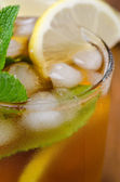 Close-up of ice tea with lemon and mint, selective focus — Stock Photo