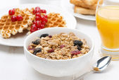 Muesli, waffles with berries and orange juice for breakfast — Foto de Stock