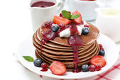 Pancakes with cream and fresh berries for breakfast, isolated — Stock Photo