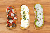 Ciabatta with tomatoes, goat cheese, pate with green peas — Stock Photo