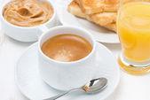 Freshly brewed espresso, orange juice and toast for breakfast — Stock Photo