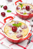 Clafoutis with cherries in red ramekin — Stock Photo