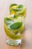 Cold fresh lemonade with lemon, lime and mint — Stock Photo