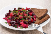 Russian beetroot  salad with bread - vinaigrette, close-up — Stock Photo