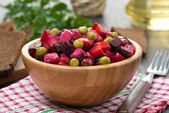 Russian beetroot salad vinaigrette in a wooden bowl — Stock Photo
