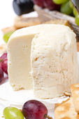 Fresh cheese and fruit, close-up — Stock Photo