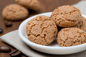 Biscotti cookies in a white bowl on a wooden table, close-up — Stock Photo