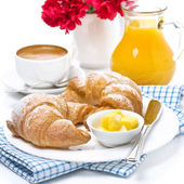 Fresh croissants with butter for breakfast — Stock Photo