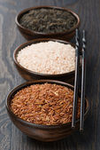Assorted rice in bowl and chopsticks — Stock Photo