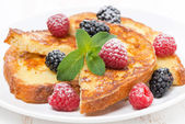 French toast with fresh berries, mint and powdered sugar — Stock Photo