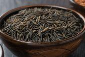 Wild rice in ceramic bowl, close-up — Stock Photo
